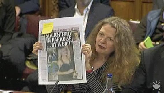 Joan holding paper